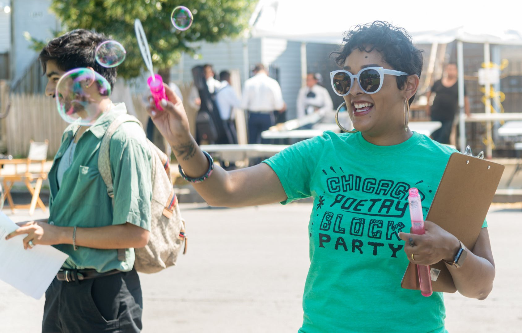 Eve blowing bubbles at a Chicago block party