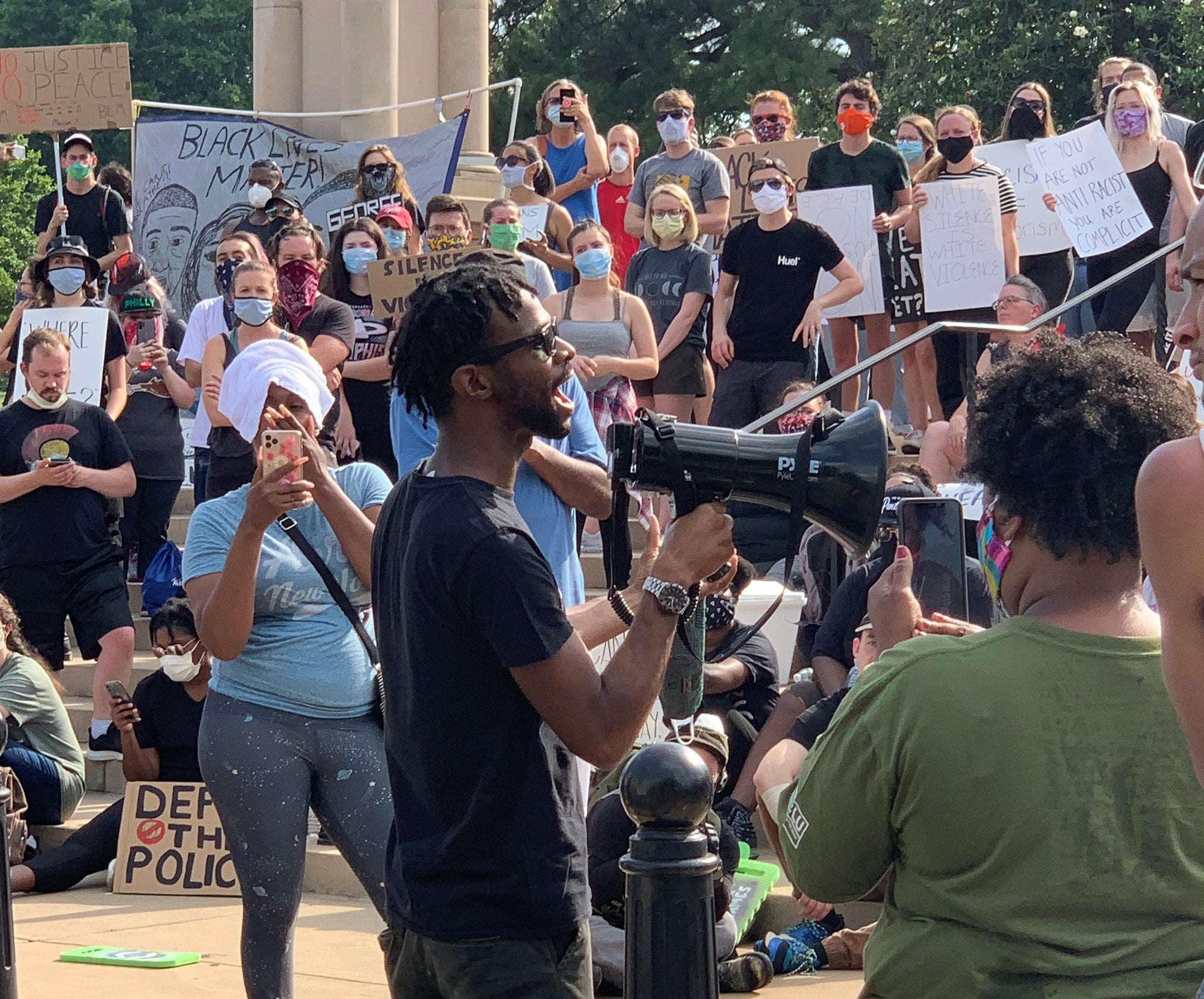 Shakur with a megaphone at a Little Rock rally against police violence